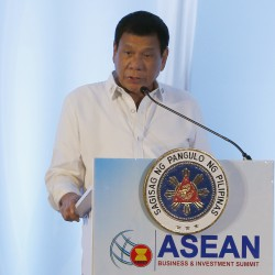Philippine President Rodrigo Duterte addresses delegates of the ASEAN Business and Investment Summit, a parallel summit in the ongoing 28th and 29th ASEAN Summits and other related summits Tuesday, Sept. 6, 2016 in Vientiane, Laos. (AP Photo/Bullit Marquez)