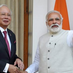 New Delhi: Prime Minister Narendra Modi shake hands with  his Malaysian counterpart Najib Razak and waves to a gathering, before their meeting at Hyderabad House in New Delhi on Saturday. PTI Photo by Shahbaz Khan(PTI4_1_2017_000096B)